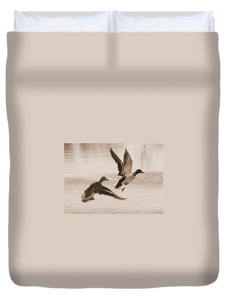Two Winter Ducks In Flight Duvet Cover by Carol Groenen