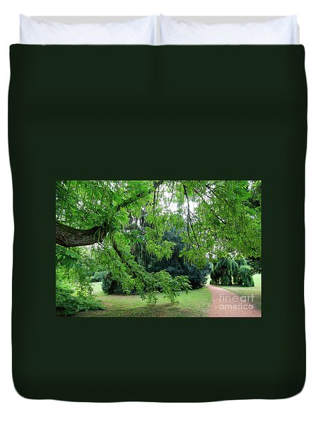 Duvet Cover featuring the photograph Under The Branches Of A Large Tree by Michal Boubin