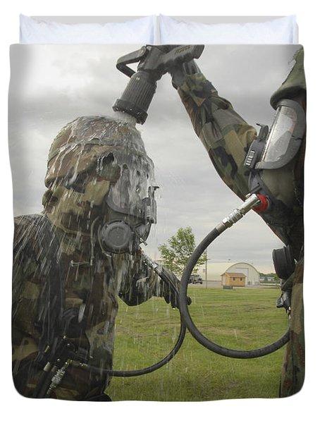 U.s. Air Force Soldier Decontaminates Duvet Cover by Stocktrek Images