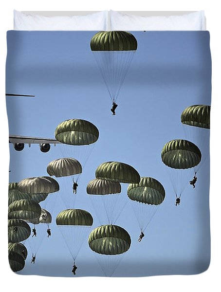 Duvet Cover featuring the photograph U.s. Army Paratroopers Jumping by Stocktrek Images