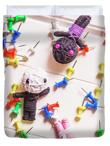 Voodoo Dolls Surrounded By Colorful Thumbtacks Duvet Cover