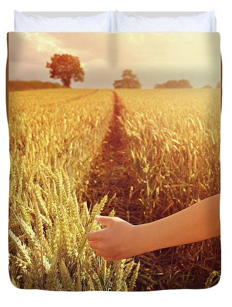 Duvet Cover featuring the photograph Walking Through Wheat Field by Lyn Randle