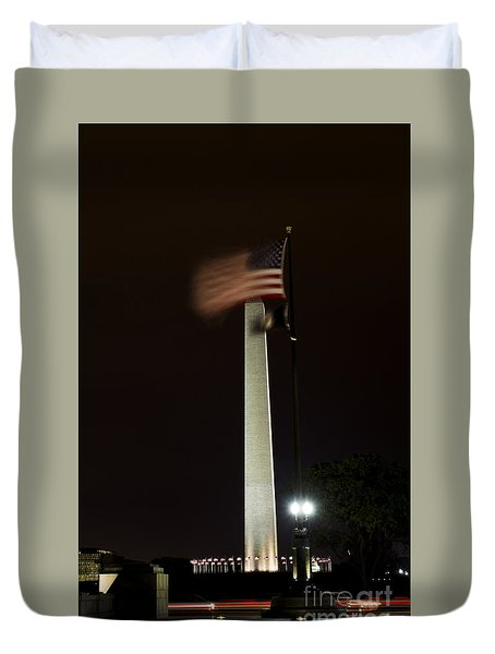 Duvet Cover featuring the photograph Washington Monument At Night With Flag by Angela DeFrias