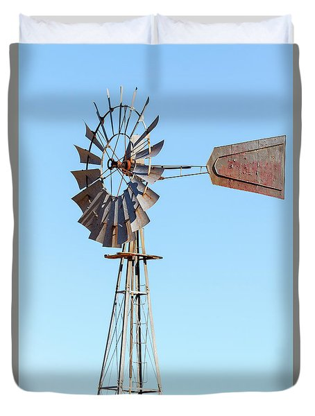 Water Pump Windmill On Blue Sky Background Duvet Cover by David Gn