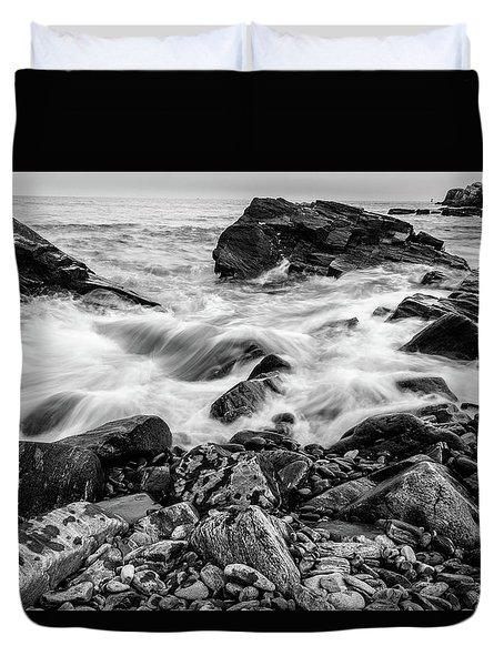Duvet Cover featuring the photograph Waves Against A Rocky Shore In Bw by Doug Camara