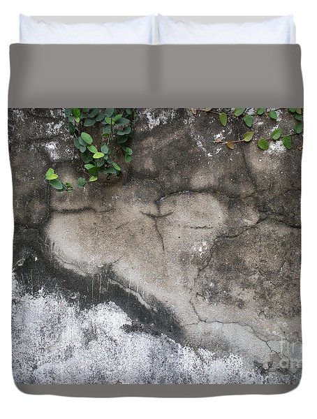Duvet Cover featuring the photograph Weathered Broken Concrete Wall With Vines by Jason Rosette