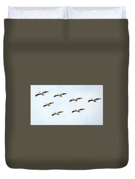 White Pelican Flyby Duvet Cover by Ricky L Jones
