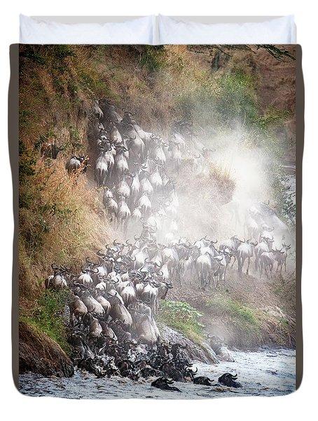 Wildebeest Climbing Up Mara River Bank Duvet Cover