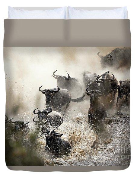 Wildebeest Herd Crossing The Mara River Duvet Cover