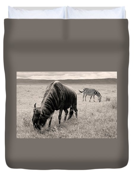 Duvet Cover featuring the photograph Wildebeest And Zebra by Stefano Buonamici