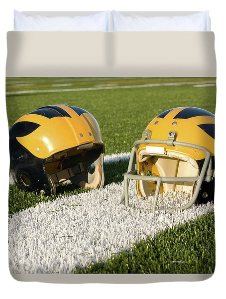 Wolverine Helmets From Different Eras On The Field Duvet Cover