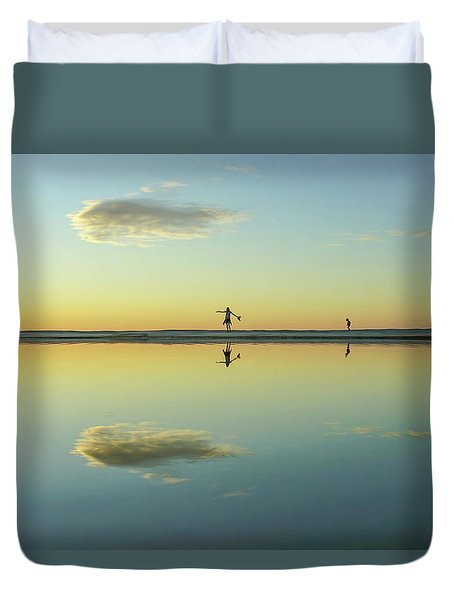 Woman And Cloud Reflected On Beach Lagoon At Sunset Duvet Cover