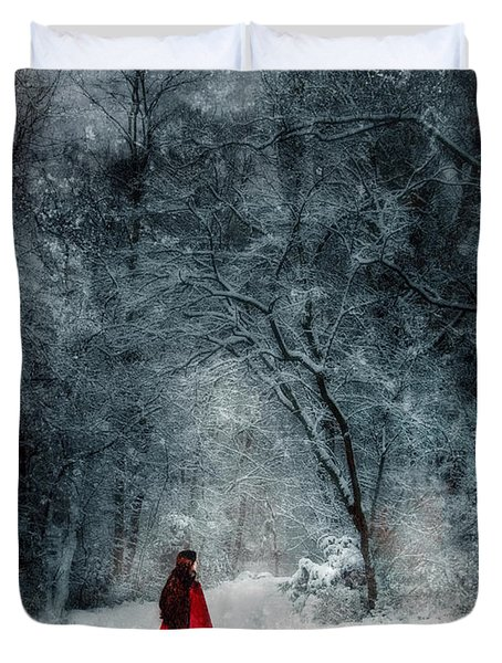 Woman In Red Cape Walking In Snowy Woods Duvet Cover by Jill Battaglia