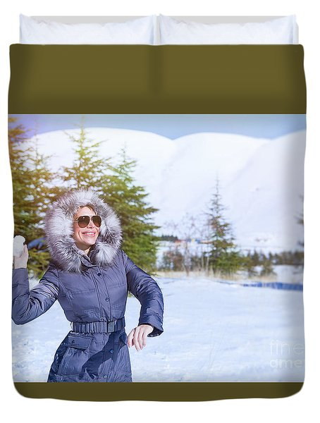 Woman Playing In Winter Park Duvet Cover