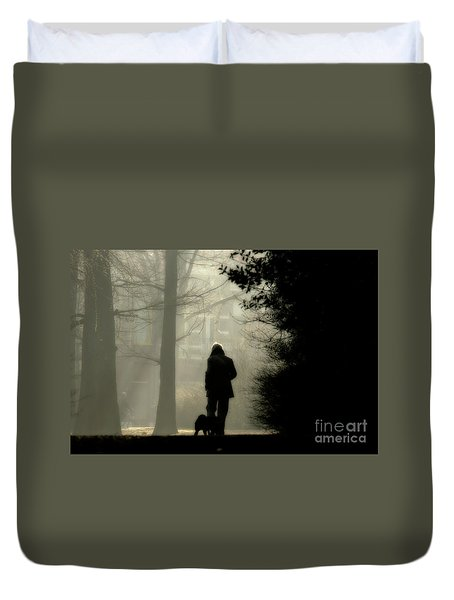 Duvet Cover featuring the photograph Woman Walking Dog by Patricia Hofmeester