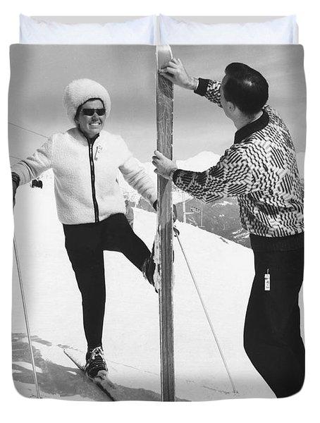 Women Waxing Skis Duvet Cover