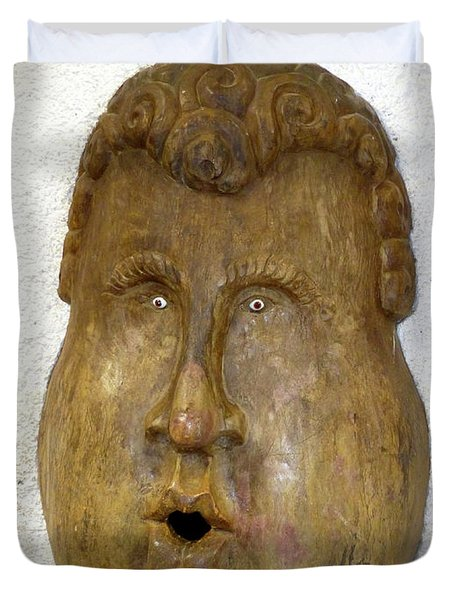 Duvet Cover featuring the photograph Wood Carved Face by Francesca Mackenney