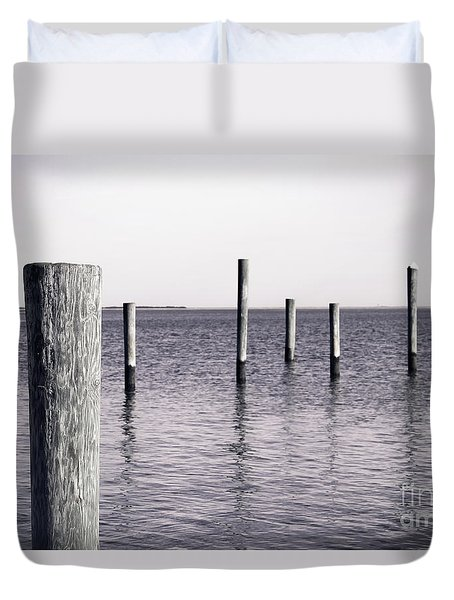 Duvet Cover featuring the photograph Wood Pilings In Monotone by Colleen Kammerer