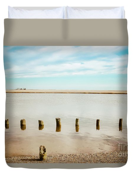 Duvet Cover featuring the photograph Wood Pilings In Shallow Waters by Colleen Kammerer
