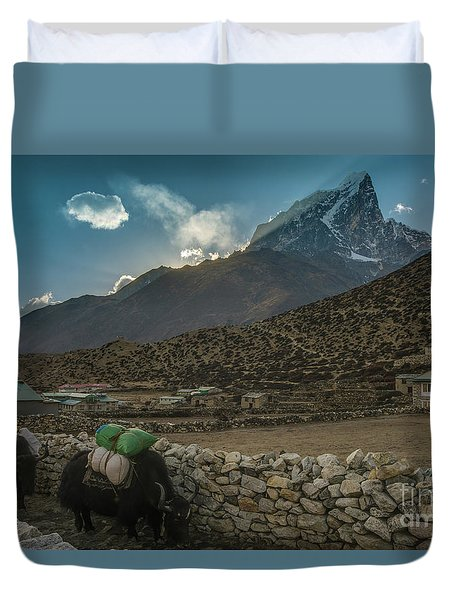Duvet Cover featuring the photograph Yaks Moving Through Dingboche by Mike Reid