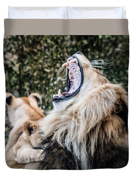 Duvet Cover featuring the photograph Yawning Lion by Cathy Donohoue