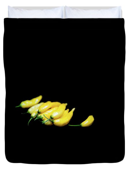 Yellow Chillies On A Black Background Duvet Cover