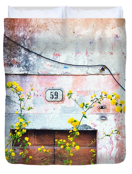 Yellow Flowers And Decayed Wall Duvet Cover