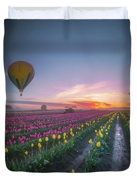 Duvet Cover featuring the photograph Yellow Hot Air Balloon Over Tulip Field In The Morning Tranquili by William Lee