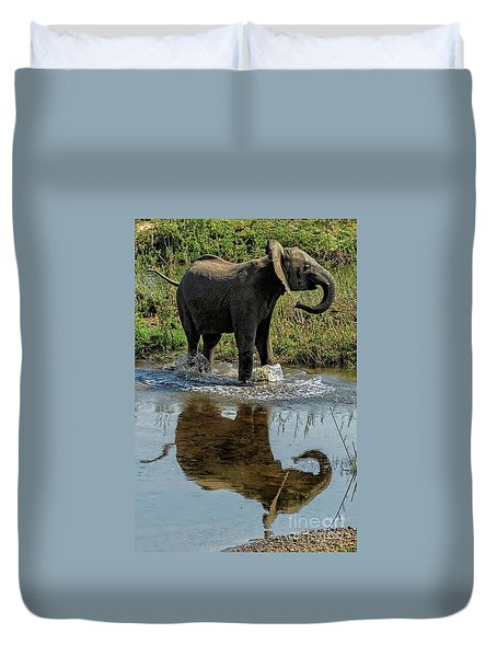 Young Elephant Playing In A Puddle Duvet Cover