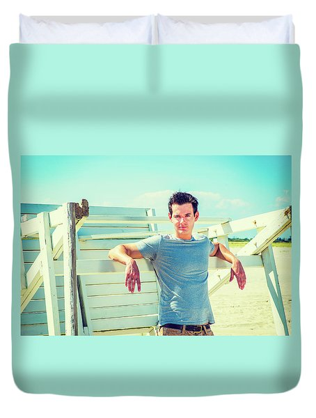 Young Man Relaxing On The Beach Duvet Cover