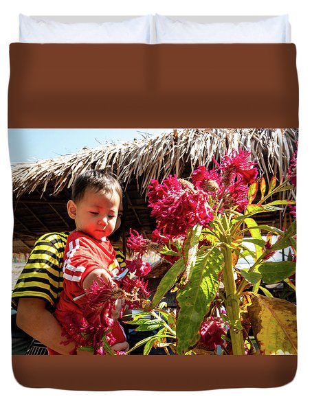 A Small Person With Reflected Flowers Duvet Cover