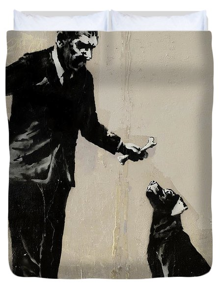 Duvet Cover featuring the photograph Banksy Paris Man With Bone And Dog by Gigi Ebert
