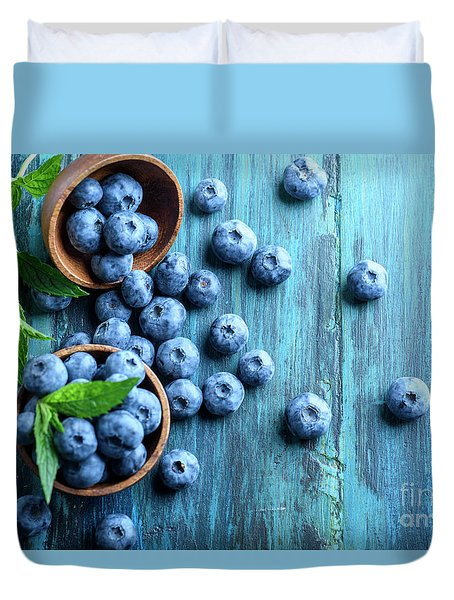 Bowl Of Fresh Blueberries On Blue Rustic Wooden Table From Above Duvet Cover