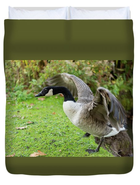 Duvet Cover featuring the photograph Canadian Goose With Wings Stretched by Scott Lyons
