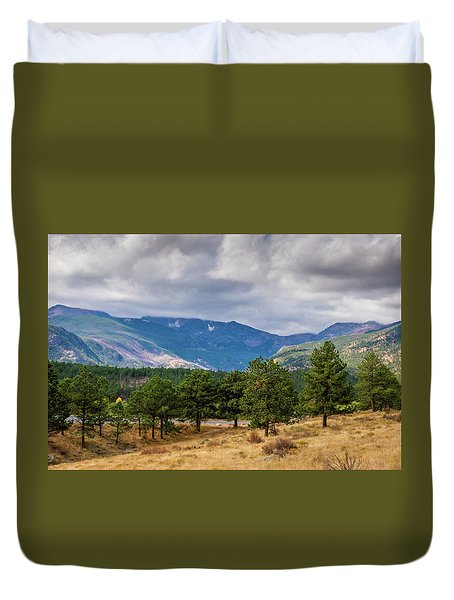 Duvet Cover featuring the photograph Clouds Over The Rockies by James L Bartlett