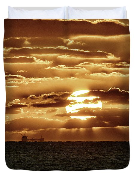 Duvet Cover featuring the photograph Dramatic Atlantic Sunrise With Ghost Freighter In Goldtone by Bill Swartwout Fine Art Photography