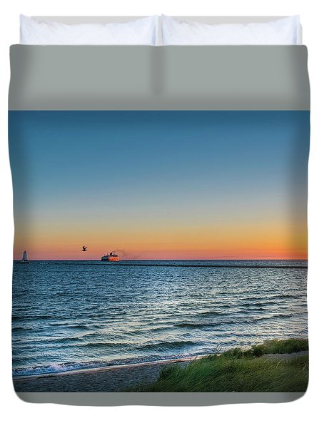 Ferry Going Into Sunset Duvet Cover