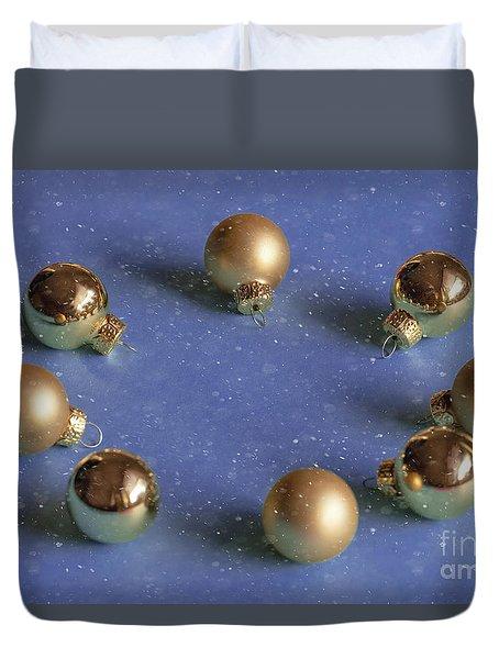 Golden Christmas Balls On The Snowy Background Duvet Cover