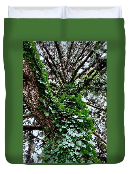 Duvet Cover featuring the photograph Leafy Tree Trunk by Lukas Miller