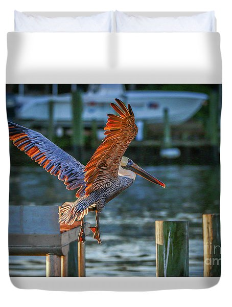 Duvet Cover featuring the photograph Pelican Approach by Tom Claud