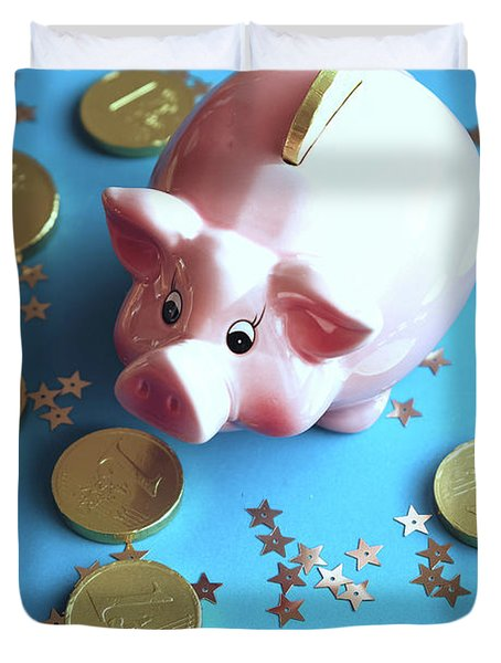 Piggy Bank On The Background With The  Chocoladen Coins Duvet Cover