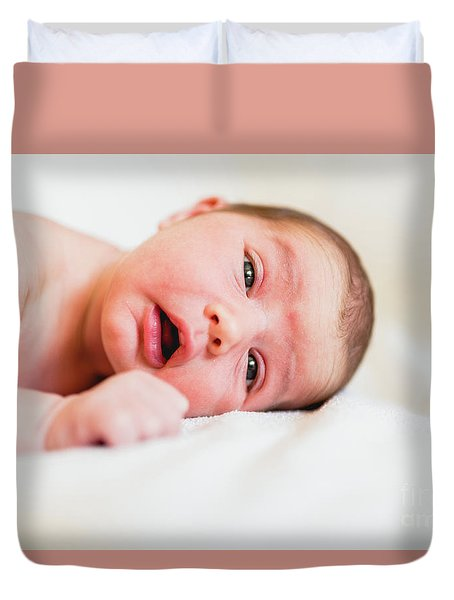 Portrait Of Newborn Baby Girl Feels Safe And Awake To A New Life. Duvet Cover