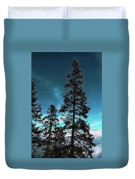 Silhouette Of Tall Conifers In Autumn Duvet Cover