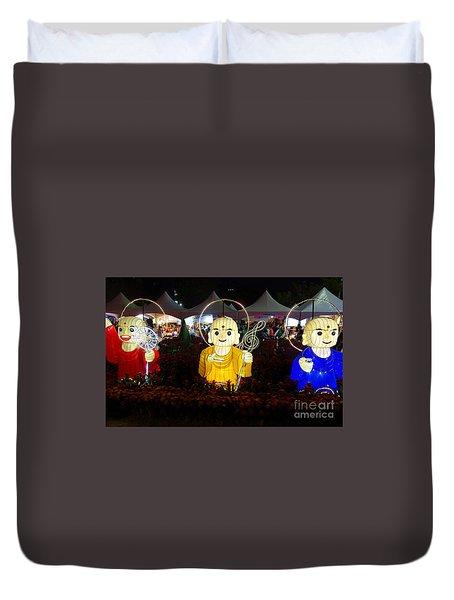 Three Lanterns In The Shape Of Buddhist Monks Duvet Cover