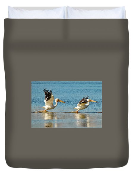 Two Pelicans Taking Off Duvet Cover