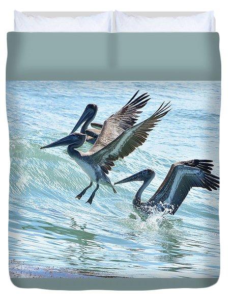 Wave Hopping Pelicans Duvet Cover