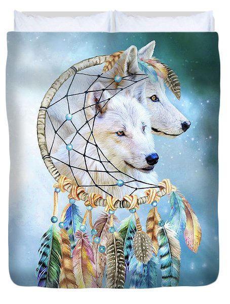 Duvet Cover featuring the mixed media Wolf Dreams by Carol Cavalaris