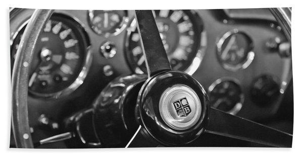 Hand Towel featuring the photograph 1968 Aston Martin Steering Wheel Emblem by Jill Reger