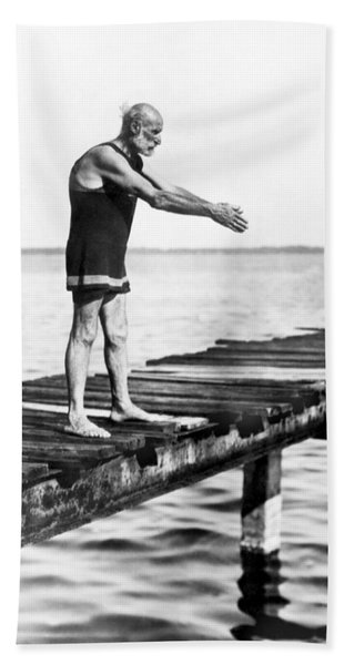 An Old Man Prepares To Dive Hand Towel
