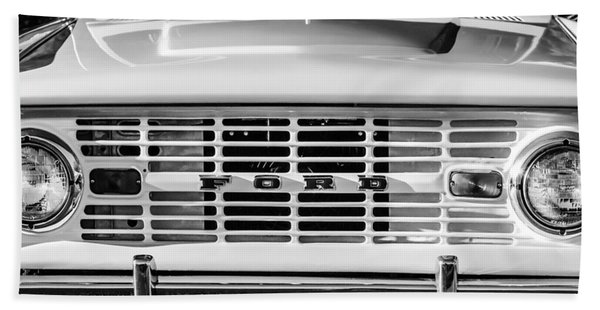 Hand Towel featuring the photograph Ford Bronco Grille Emblem -0014bw by Jill Reger